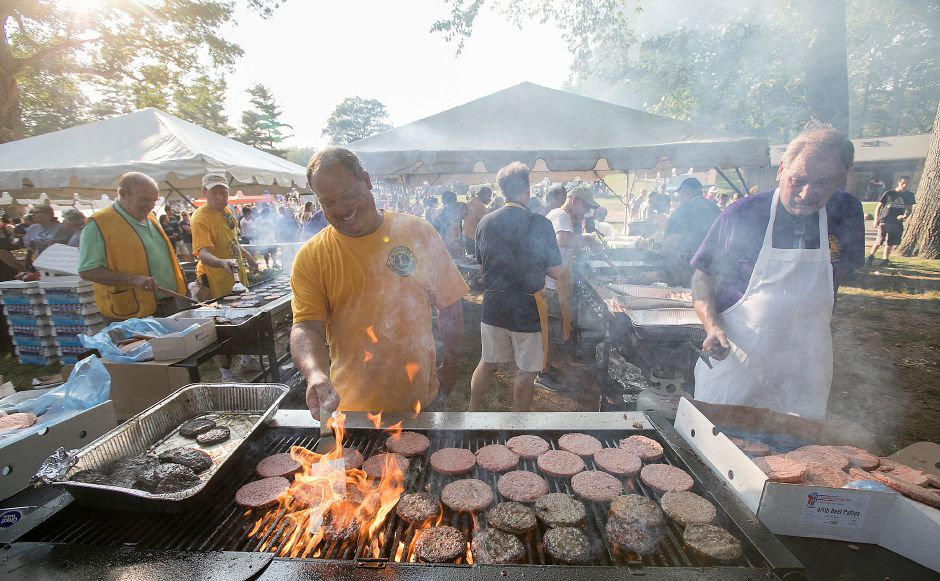 Meriden Lions Club members cook up burgers during the 13th Annual National Night Out hosted by the Meriden Police Department at Hubbard Park in Meriden, Tuesday, August 1, 2017. | Dave Zajac, Record-Journal