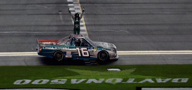 Austin Hill (16) celebrates his win in a NASCAR Truck Series auto race Friday, Feb. 15, 2019, at Daytona International Speedway in Daytona Beach, Fla. (AP Photo/Chris O