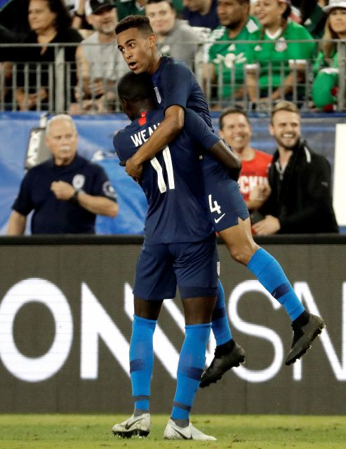 U.S. midfielder Tyler Adams (4) celebrates with Tim Weah (11) after Adams scored a goal against Mexico during an international friendly match, Tuesday, Sept. 11, 2018, in Nashville, Tenn. The U.S. won 1-0. (AP Photo/Mark Humphrey)