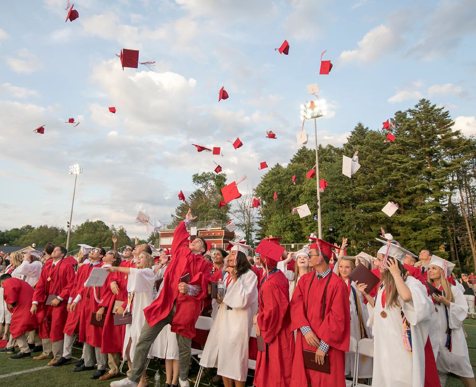Class of 2018 graduates throw their caps at conclusion of graduation ceremonies at Cheshire High School, Thursday, June 21, 2018. Dave Zajac, Record-Journal