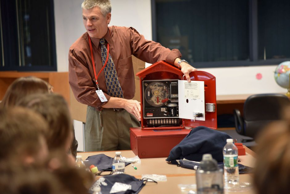 FILE PHOTO: Test Engineering Manager at Honeywell Security and Fire, Dean Page, presents about his company to students at Coginchaug Regional High School on Monday, Oct. 22, 2018. Page