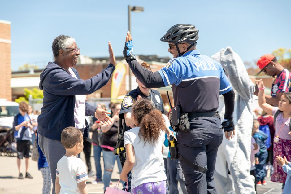 Plainville Police Officer Timothy Miller danced with kids during the Family Fest on May 11. | Devin Leith-Yessian, The Citizen