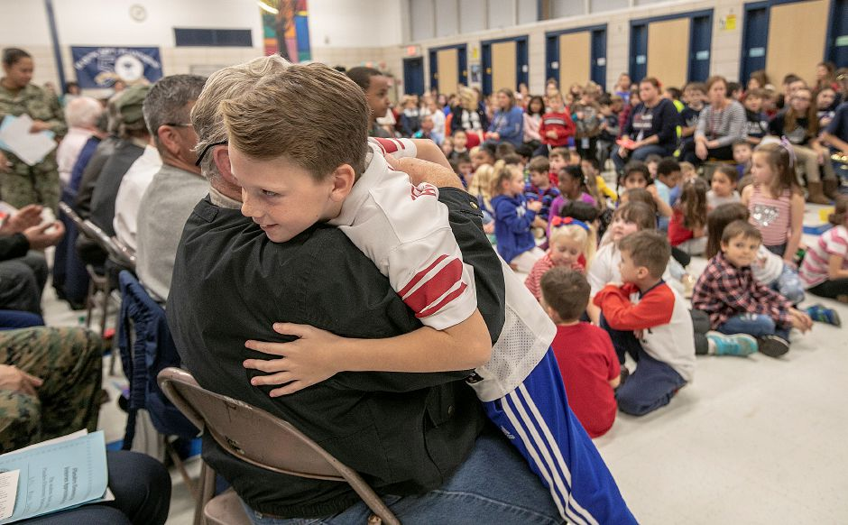 U.S. Army veteran Joseph Pelletier, of Southington, is hugged by grandson, Nathan, 9, during a school assembly honoring veterans at Flanders Elementary School in Southington, Friday, Nov. 9, 2018. Dave Zajac, Record-Journal