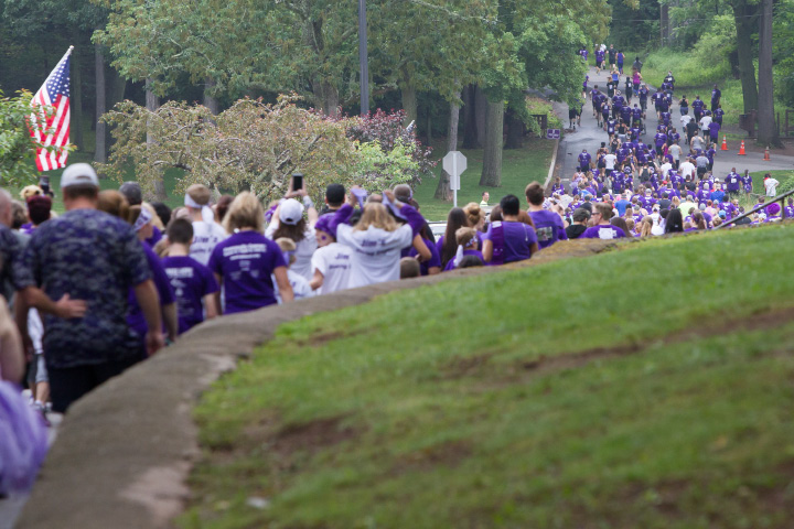 Walkers head up the hill into Hubbard Park Saturday during the PurpleStride 5k and walk fundraiser for Pancreatic Cancer Action Network at Hubbard Park in Meriden Jun. 17, 2017 | Justin Weekes / For the Record-Journal
