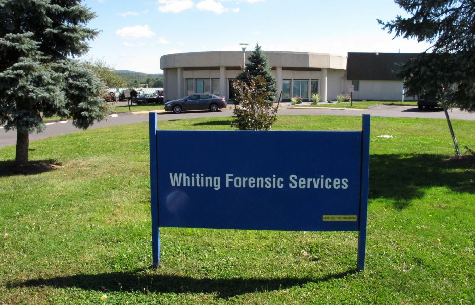 The Whiting Forensic Division maximum-security psychiatric hospital in Middletown, Conn., is seen on Friday, Sept. 15, 2017. Thirty-one staff members have been suspended and nine have been arrested in connection with the alleged abuse of a patient. A state lawmaker says more allegations of staff misconduct are emerging after the suspensions and arrests. (AP Photo/Dave Collins)