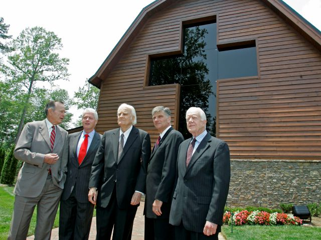 FILE - In this May 31, 2007 file photo, former Presidents, George H.W. Bush, left, Bill Clinton, second left, and Jimmy Carter, right, join Franklin Graham, second right, as they pose with Billy Graham, center, in front of the Billy Graham Library in Charlotte, N.C. Graham, who transformed American religious life through his preaching and activism, becoming a counselor to presidents and the most widely heard Christian evangelist in history, has died. Spokesman Mark DeMoss says Graham,...