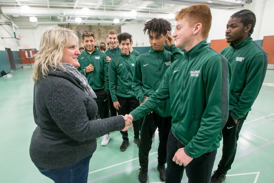Maloney Principal Jennifer Straub greetes Devin Juan Friday during a pep rally for the soccer team reaching the state finals at Maloney High School in Meriden November 16, 2018 | Justin Weekes / Special to the Record-Journal