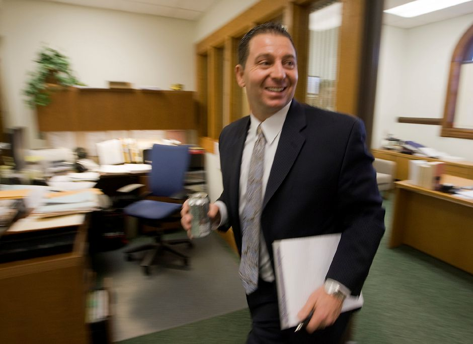 Seemingly always on the go, Superintendent Mark D. Benigni heads to a District Data Team Meeting at the Board of Education in Meriden Wednesday January 11, 2012. (Dave Zajac/Record-Journal)