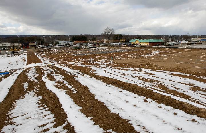 Property Development Chick : Southington — surrounded by stores and restaurants on busy