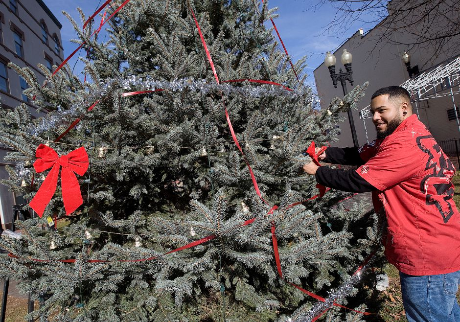 David Ortiz, owner of Feel Fresh Hair Studio, took it upon himself to decorate a Christmas tree recently set up by the City next to Middlesex Community College on West Main St. in downtown Meriden, Wednesday, November 20, 2013. Ortiz