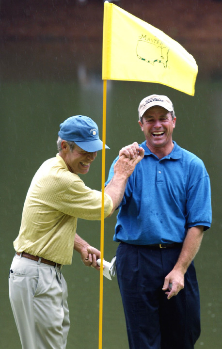 FILE - In this April 10, 2003, file photo, Jerry Pate, right, is all smiles as he is greeted by Ben Crenshaw, left, at the ninth green after sinking the ball for par on a penalty shot from the tee box in the Masters
