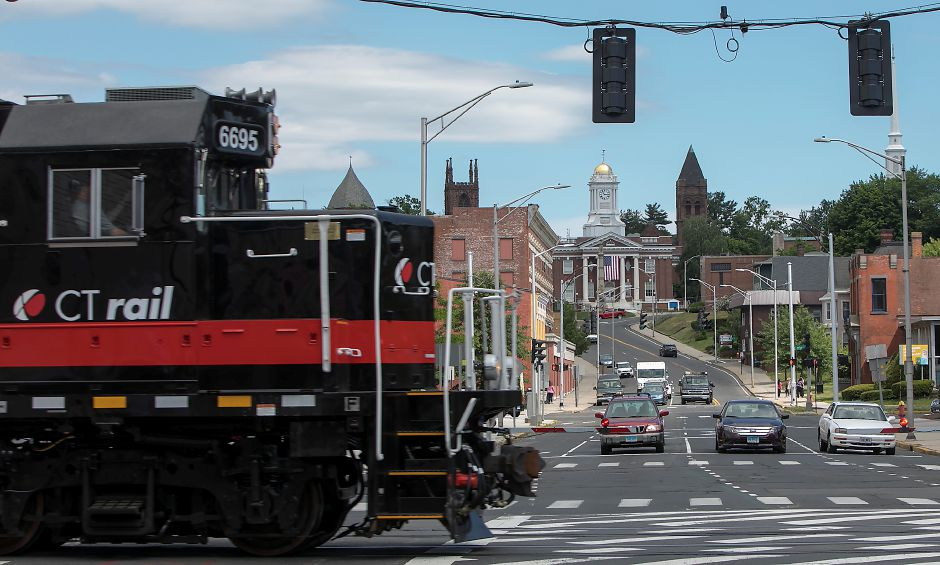 "A CTrail train travels south Monday at the East Main Street crossing in Meriden. The state Department of Transportation has begun running ""test trains"" in preparation of the new Hartford Line rail service, scheduled to begin Saturday. Dave Zajac, Record-Journal"