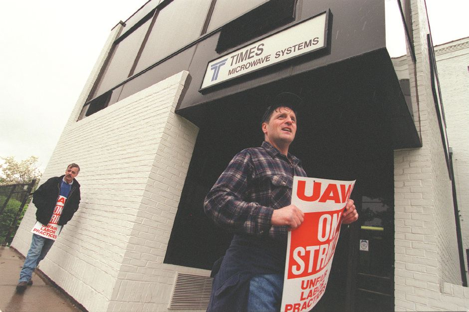RJ file photo - Ted Burdacki, foreground, and Mel Jimmo, Times Microwave employees, walk the picket line at the Wallingford company May 11, 1998.