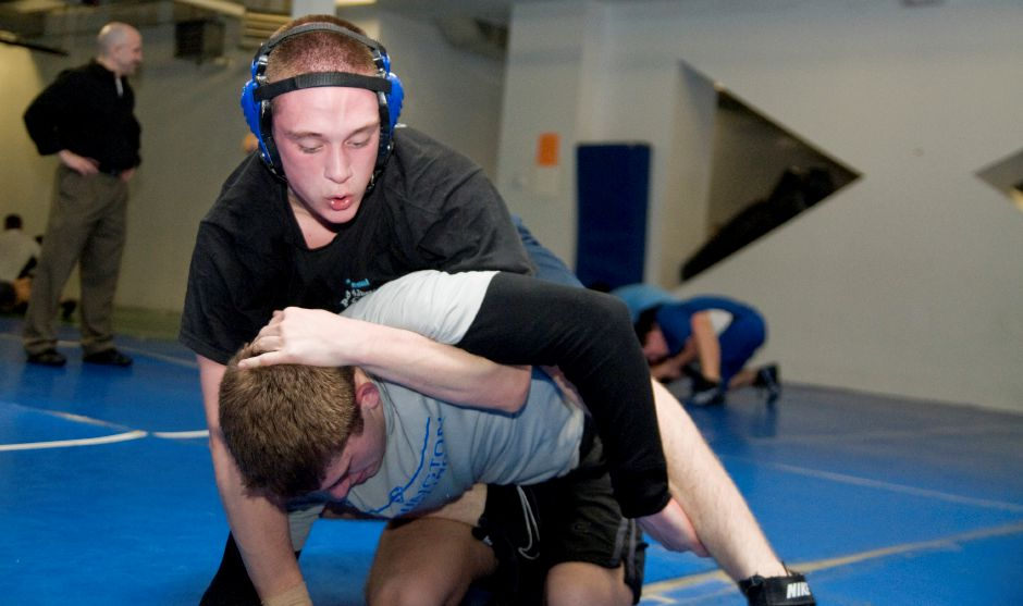 Southington wrestling captain Mark Jaffer attempts to force teammate Ryan Dupuis
