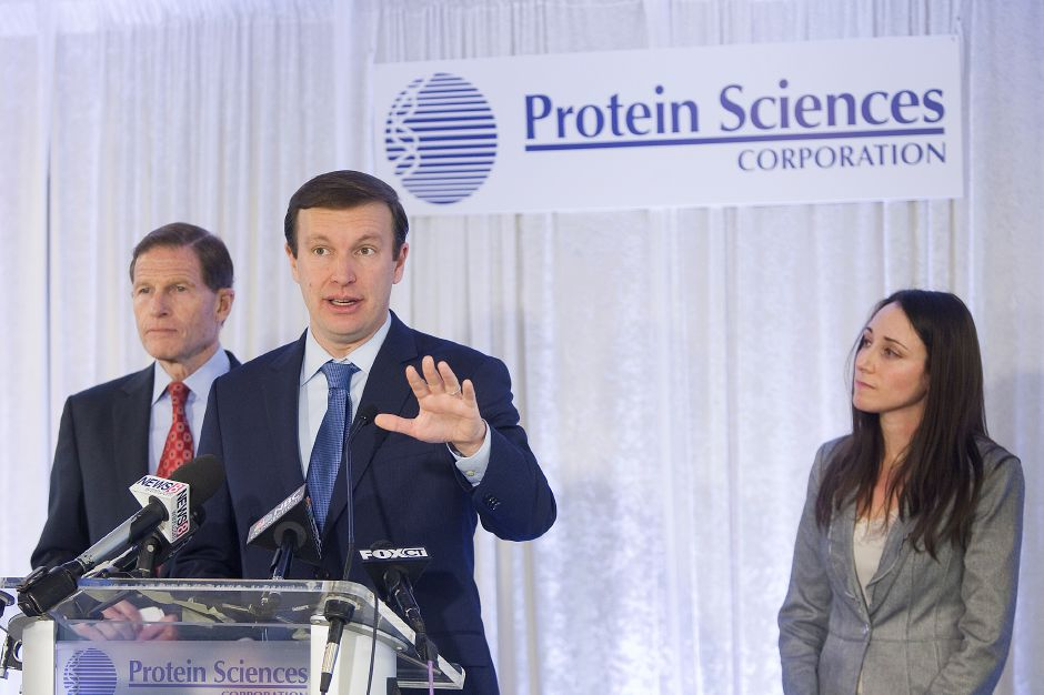 U.S. Senator Chris Murphy speaks during a press conference at Protein Sciences in Meriden, Tuesday, December 23, 2014. U.S. Sens. Chris Murphy and Richard Blumenthal will call on the Centers for Disease Control to increase distribution of Flublok, a vaccine developed at Protein Sciences on Research Parkway. At right is Rachael Felberbaum, director of corporate communications at Protein Sciences. | Dave Zajac / Record-Journal