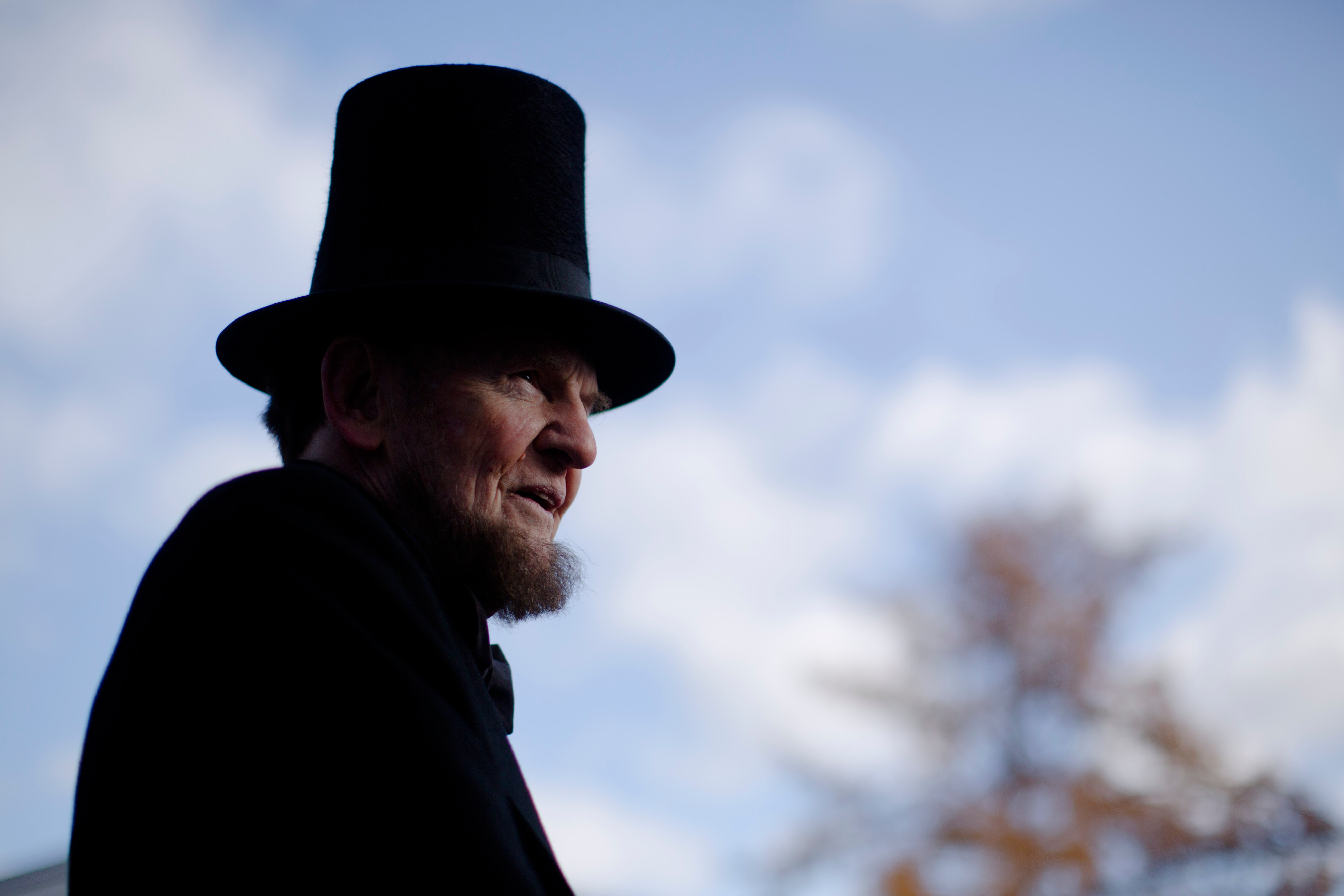 James Getty, portraying President Abraham Lincoln, stands before a ceremony commemorating the 150th anniversary of the dedication of the Soldiers National Cemetery and President Abraham Lincoln