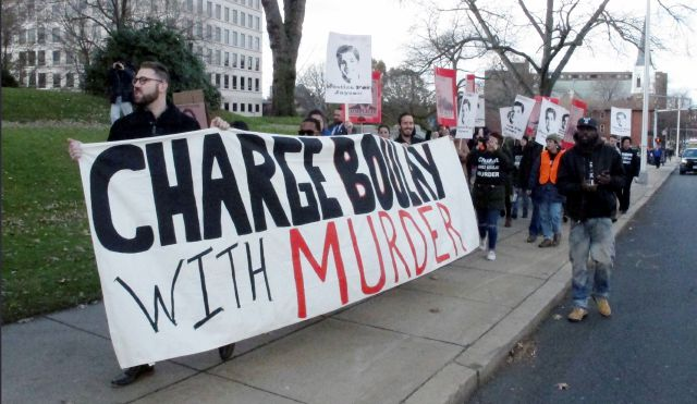 Protesters demonstrate, Monday, Nov. 27, 2017, in Hartford, Conn., to call for criminal charges against Bridgeport police officer James Boulay,who fatally shot 15-year-old Jayson Negron and wounded another man in May. A state prosecutor says the shooting remains under investigation. (AP Photo/Dave Collins)