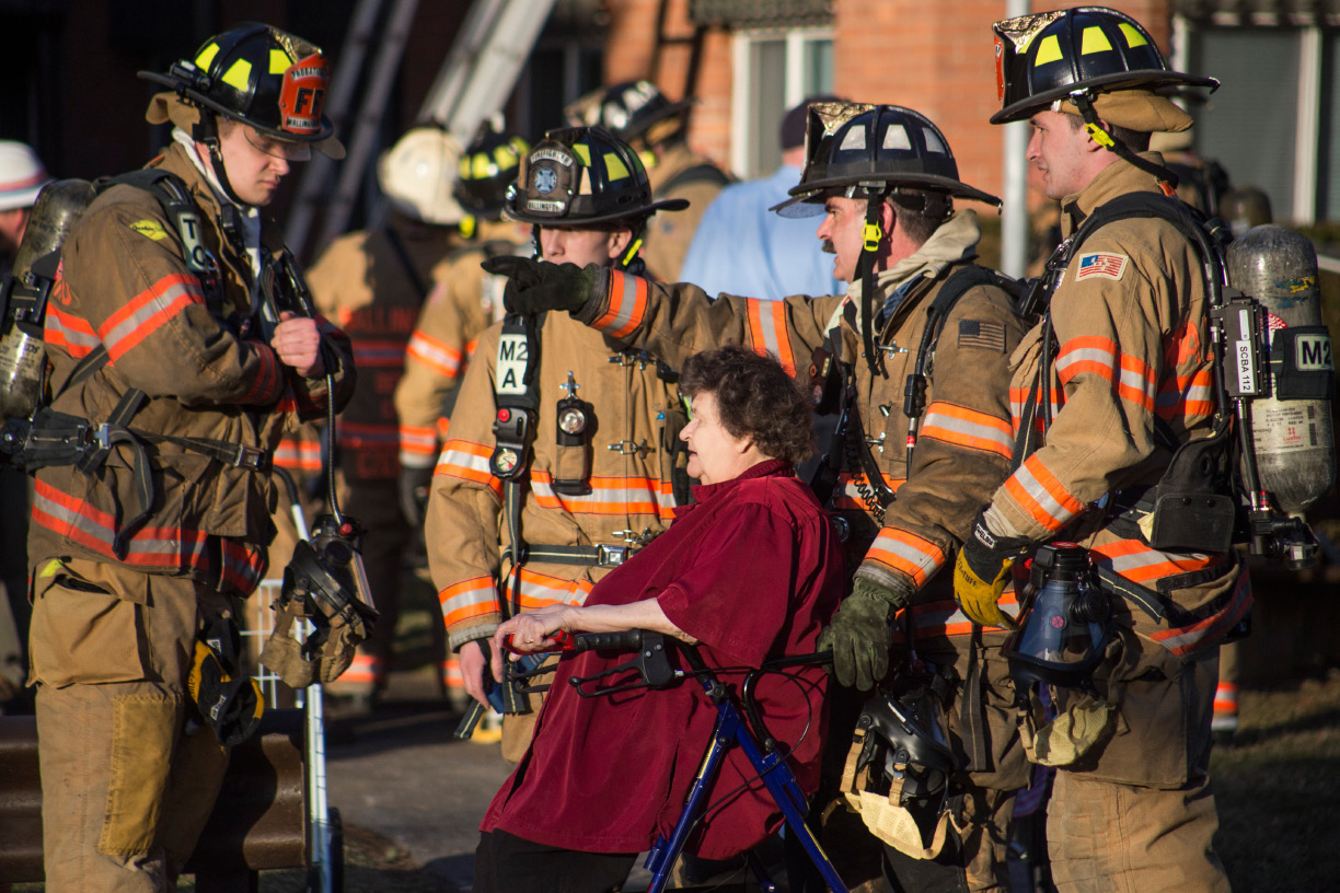 Wallingford firefighters escourt residents from Silver Pond Aparments in Wallingford Friday Feb. 24, 2017 after a fire on the second floor of the complex. | Richie Rathsack, Record-Journal
