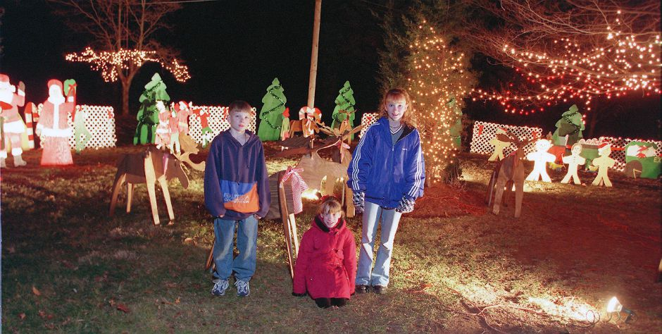 Matthew English, left, counsin Jacelyn Curley, center and Melissa English, right, stand in their yard on the Meriden-Waterbury Turnpike in Southington, Dec. 1998.