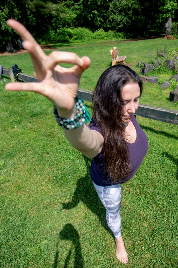 Brianne Barrett, owner of Bhogah Yoga School in Wallingford, shows some yoga techniques at Guiffrida Park in Meriden May 31, 2019. Barrett will lead several yoga classes in conjunction with the Meriden Parks & Recreation Department over the summer at Hubbard Park, Guiffrida Park and the Meriden Green. | Richie Rathsack, Record-Journal