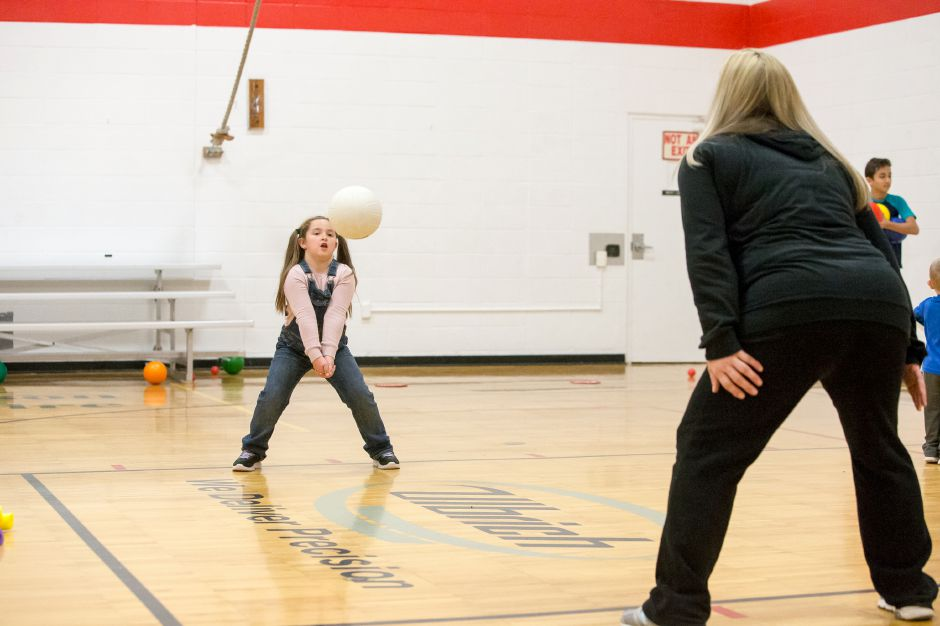 Danica Thompson 6 plays volleyball with Michelle Huntington Saturday during Turkey Palooza at the Wallingford YMCA in Wallingford November 17, 2018 | Justin Weekes / Special to the Record-Journal