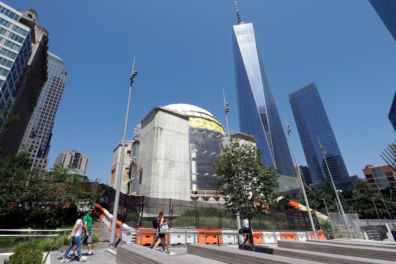 In this Aug. 10, 2017 photo, the St. Nicholas National Shrine, center, designed by renowned architect Santiago Calatrava, is under construction at the World Trade Center in New York. It is replacing a tiny Greek Orthodox church that was crushed by the Trade Center