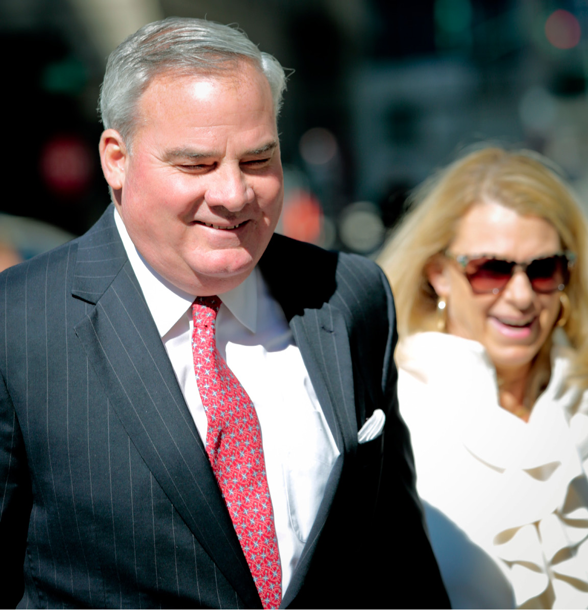 Former Connecticut Gov. John Rowland, left, leaves with his wife Patricia, right, after he appeared in federal appeals court to ask the court to overturn his political corruption conviction, Friday, March 18, 2016, in New York. (AP Photo/Bebeto Matthews)