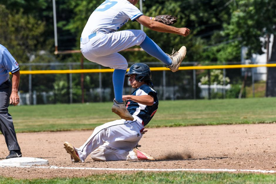Joshua Panarella slides into 3rd in Saturdays Amercan Legion state championship game against Stamford at Meridens Ceppa field