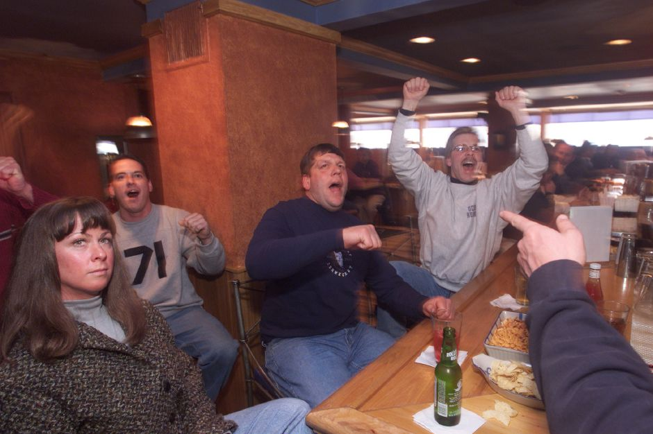 Sharon Huelsman, left, Fran Marcuss, husband Don Huelsman, center, and Bill Bohne, right, cheer as UCONN scores during the televised basketball game in Sabbatical