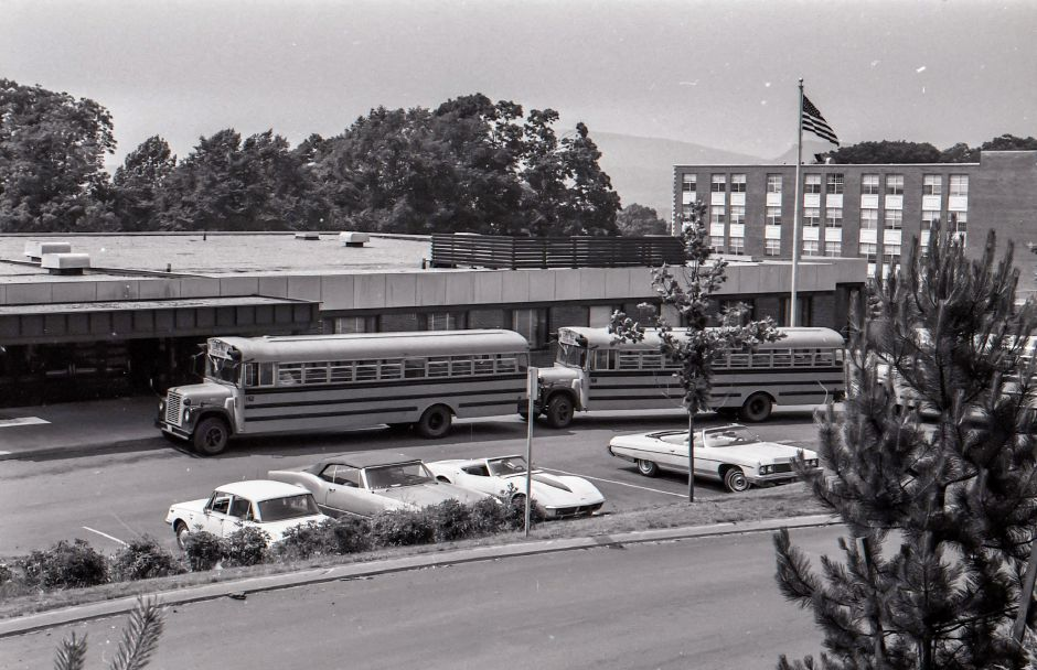 Busses line up outside of Pulaski School in Meriden, June 1975.