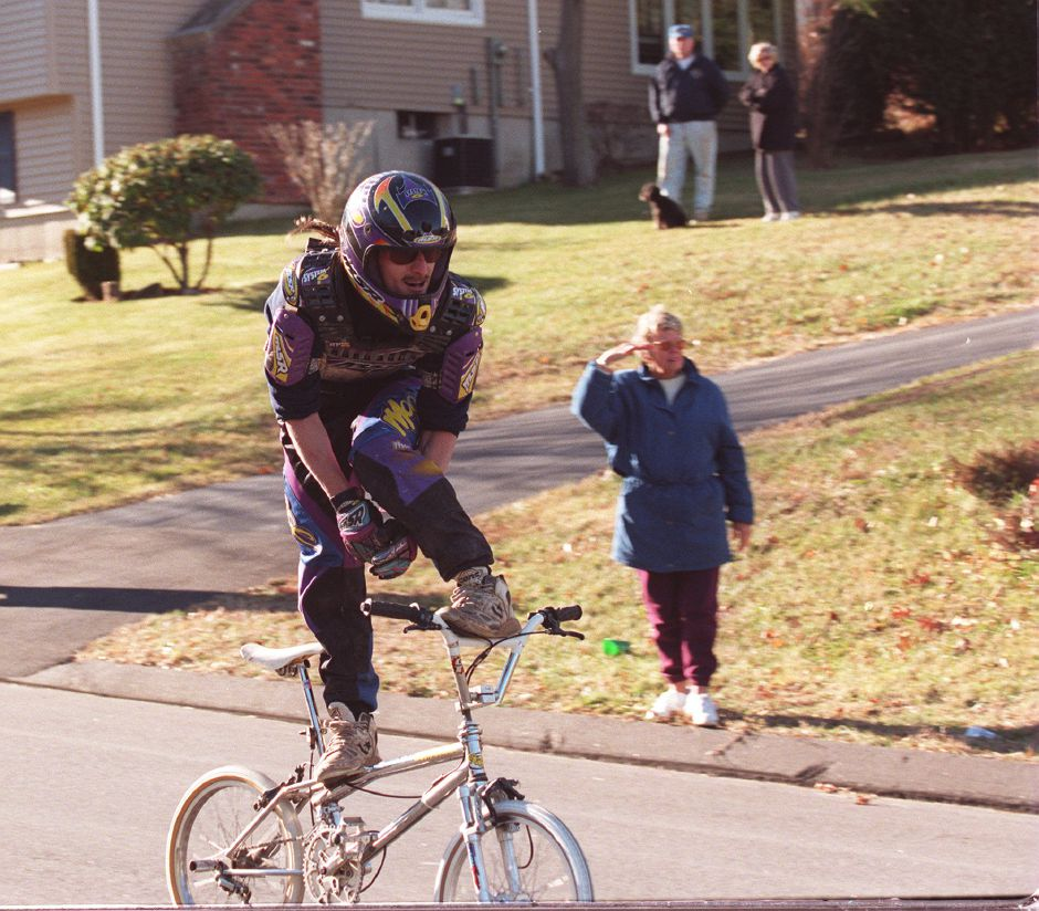 "RJ file photo - Robin Jurglewicz of Southington ""surfs"" his bike down Ardsley Road in Waterbury at a top speed of 24 mph Dec. 14, 1998. The feat was taped by a camera crew for the ""Guiness World Record Prime Time: television show."