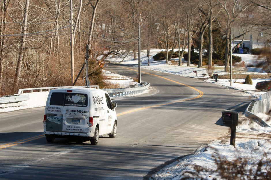 A vehicle crosses the West Center Street Bridge over Eightmile River where construction has been completed. Wednesday in Southington December 27, 2017 | Justin Weekes / For the Record-Journal