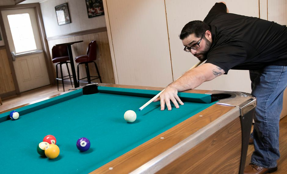 Rocco Palmieri, of Meriden, takes a shot while playing pool at the new Dawg House Bar & Grille at 999 Broad St. in Meriden, Friday, Dec. 1, 2017. The business opened in mid-November. Dave Zajac, Record-Journal