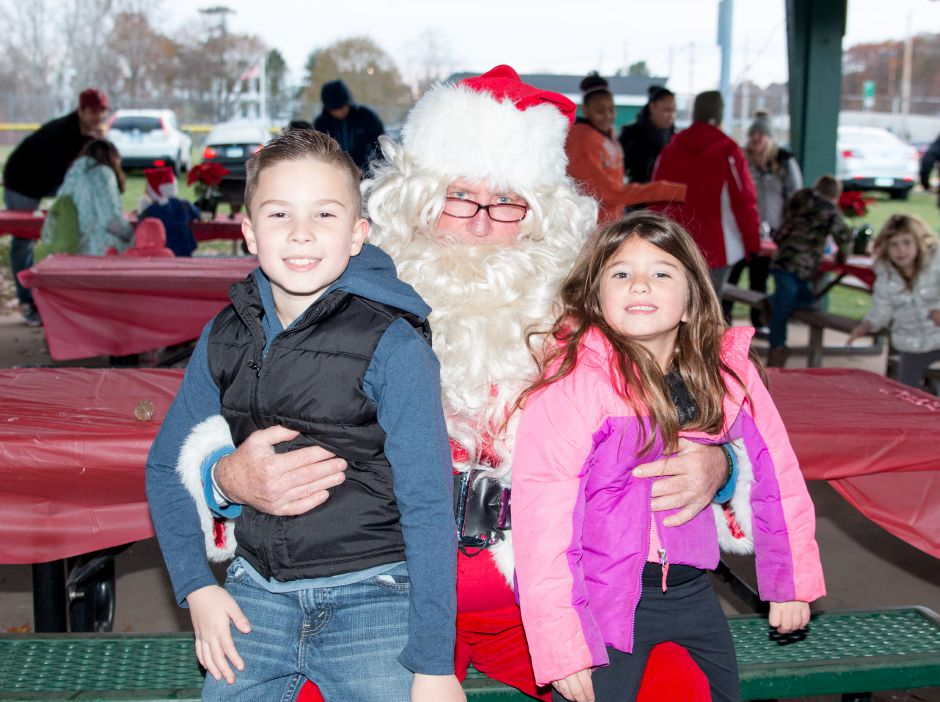 Nathan Battiparano, 8, and Ari DelGreco, 6, sit on Santa