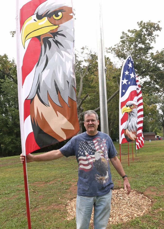Karl Berg, of Meriden, a member of the Sons of the Legion, stands with the banners he donated for the flag raising ceremony during the celebration of the American Legion's 100th anniversary at the annual American Legion Post 45 All American Picnic in Meriden on Saturday, Sept. 14, 2019. Emily J. Tilley, special to the Record-Journal.