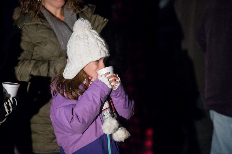Caitlin Leska 8 of Cheshire sips on hot coco Sunday during the annual tree lighting at the First Congregational Church in Cheshire December 2, 2018 | Justin Weekes / Special to the Record-Journal