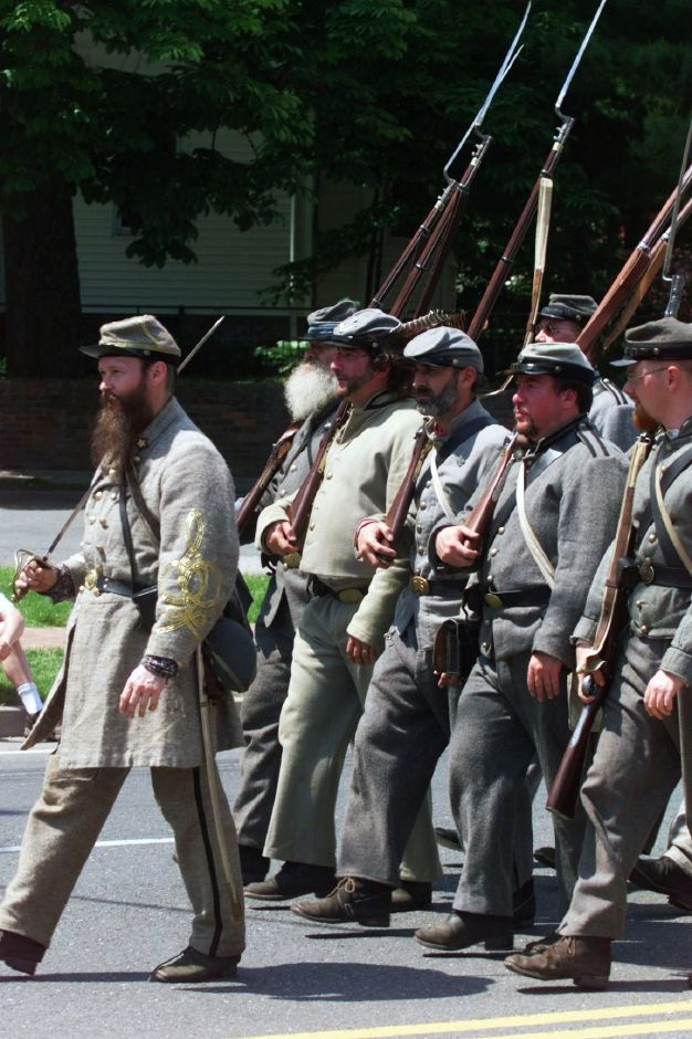 Members of the 1st Maryland Infantry Co. H Civil War Re-enactment Group parade past the Cheshire Town Green Sun., May 30, 1999 as part of Cheshire