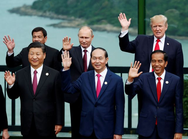 Leaders pose during the family photo session at the APEC Summit in Danang, Vietnam, Saturday, Nov. 11, 2017. Front left to right; China
