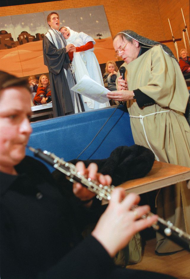 "RJ file photo - The Rev. Edmund Nadolny, right, provides the narration while Anna Skula, left, plays oboe, and Mary Tess Driver and Roman Testroet portray Mary and Joseph during a dress rehearsal for ""Touch of A Child"" Jan. 12, 1999 at St. Stanislaus Church community center in Meriden."