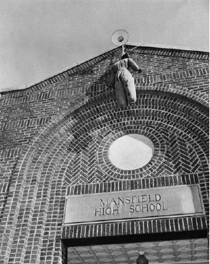 A black man hanging in effigy from main entrance of school building at Mansfield, Texas, Aug. 31, 1956, greeted schoolchildren on registration day, in protest of court order ordering blacks admitted for first time. (AP Photo)