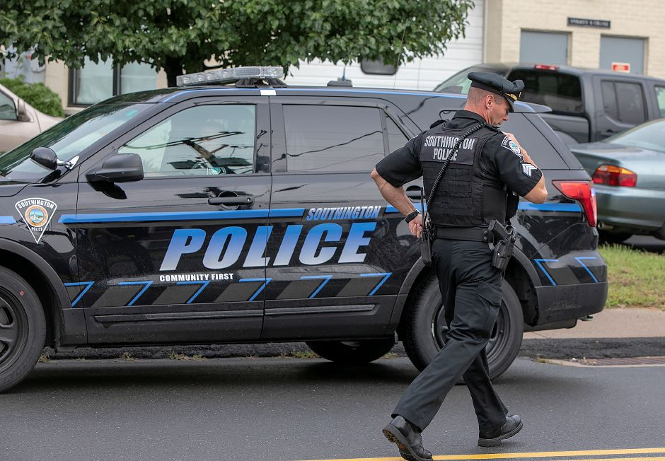 A Southington police sargeant heads off on a call with several officers during the annual 9/11 remembrance ceremony in Southington, Tuesday, Sept. 11, 2018. Dave Zajac, Record-Journal