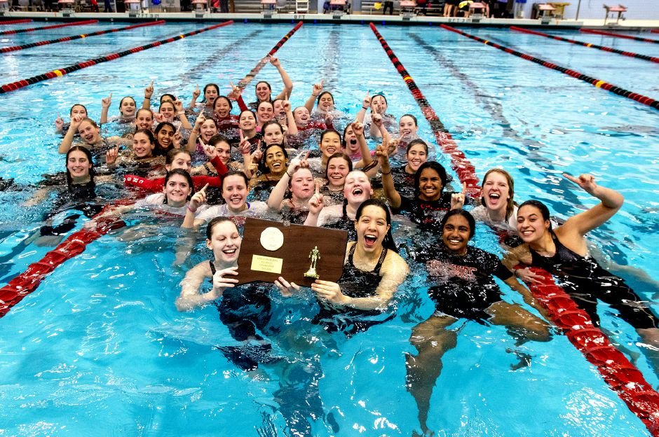 Members of the Cheshire girls swimming team celebrate after winning the CIAC Class LL state championship at Wesleyan on Tuedsay night. The Rams will look to follow it up Sunday at the State Open at Yale's Kiputh Pool.  Aaron Flaum, Record-Journal