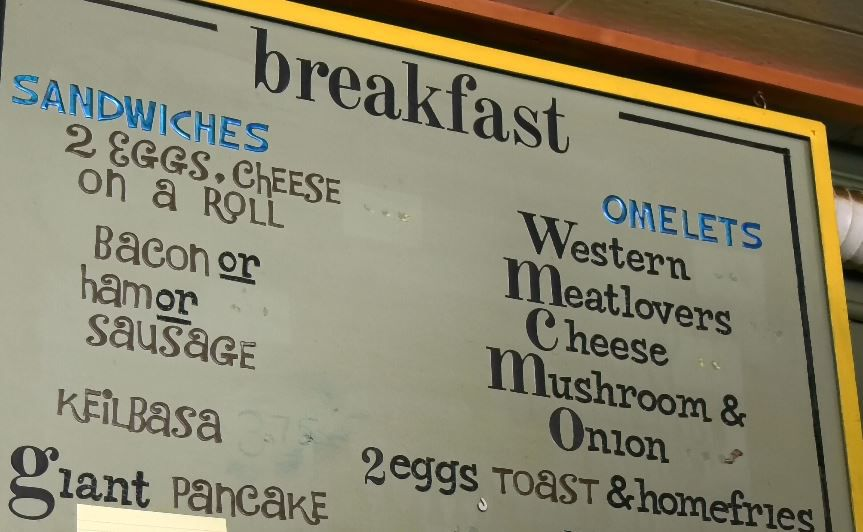 A breakfast menu on the wall at Sara J