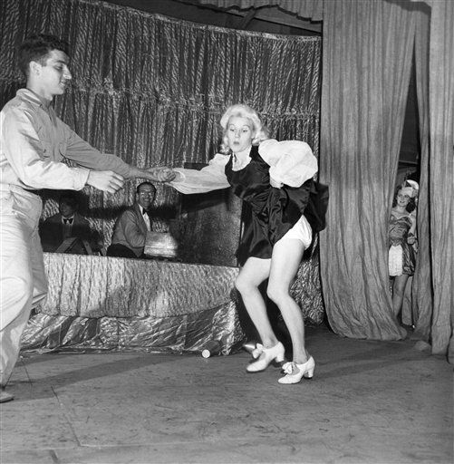 Two of the Tivoli Girls danced with two G.I.'s in a jitterbug contest, one couple shown in New Guinea on Oct. 31, 1943. (AP Photo/Pool/Life, Myron Davis)
