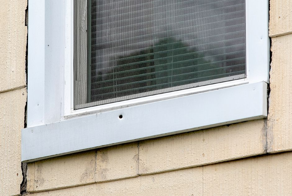 A hole in the window frame of a residence at 176 Broad St., Meriden, Mon., May 13, 2019. Police are investigating after shots were fired at the home on Friday. | Dave Zajac, Record-Journal