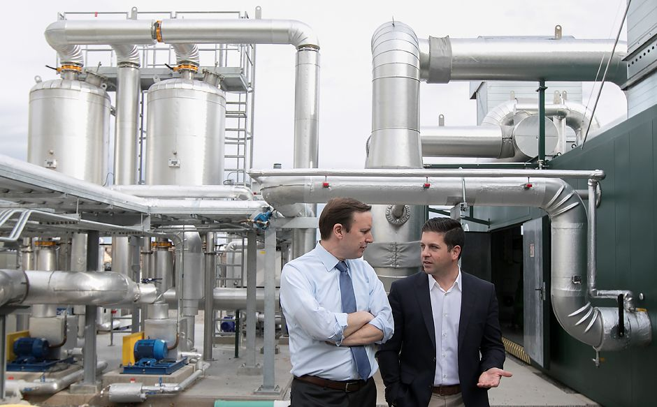U.S. Sen Chris Murphy, D-Connecticut, left, tours Quantum Biopower in Southington with Brian Paganini, vice president and managing director, Wednesday, April 12, 2017. The recycling plant converts common food waste into combustible gas and energy. | Dave Zajac, Record-Journal