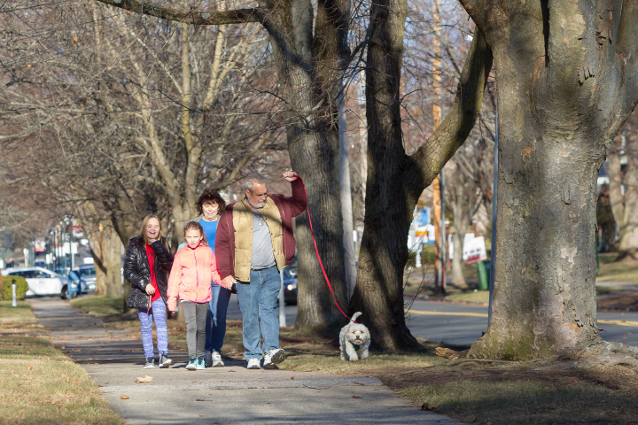 Paul and Linda Massores, of Wallingford, take a walk in the nearly 60 degree weather Tuesday, Dec. 27, 2016 with grandchildren Maya Massores, 10, Maggie Massores, 8, and Maverick, a 7 year old mix on South Main Street in Wallingford. | Justin Weekes / For the Record-Journal