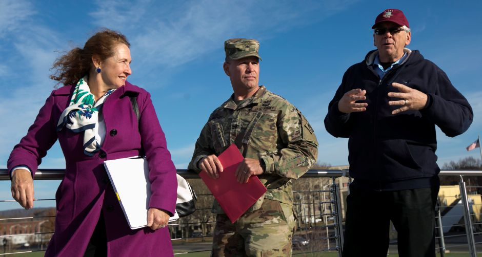 Public Works Director Bob Bass talks to U.S. Rep. Elizabeth H. Esty and Col. William Conde, district commander, U.S. Army Corps of Engineers in New England,  during a discussion at the Meriden Green on key Meriden projects on Nov. 21. Dave Zajac, Record-Journal