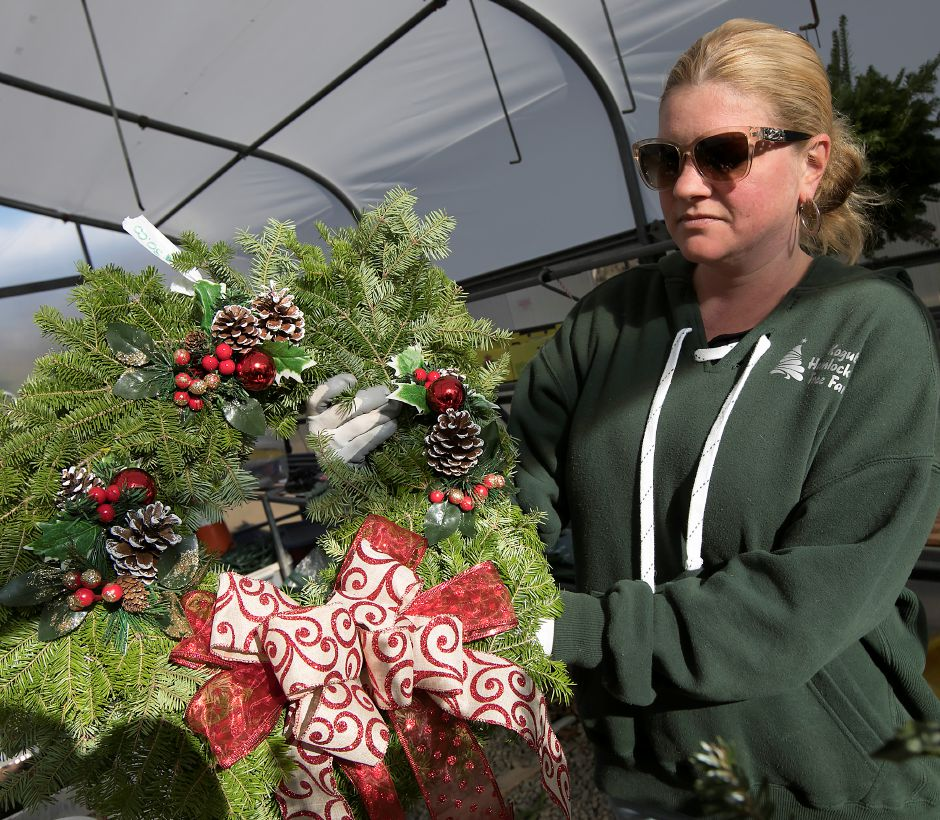 Alison Kogut, office manager, shows a wreath made at Kogut