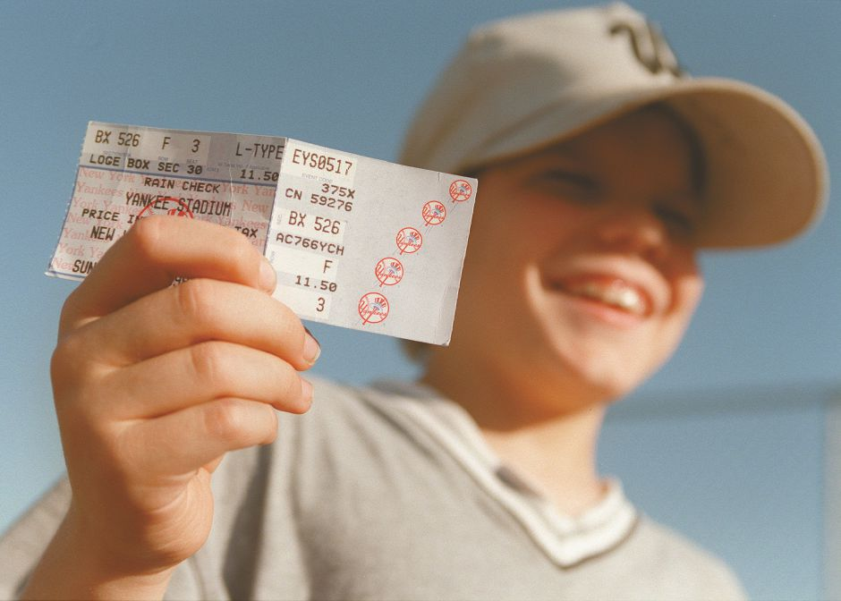 RJ file photo - Justin Keogh, 8, of Wallingford, holds his valuable souvenir - his ticket stub from David Wells